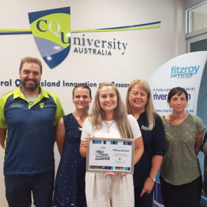 Ms Tiffany Brown is presented with her HeART of the Basin Scholarship at CQUniversity.