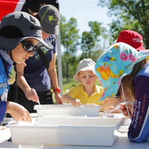School children undertake a Partnership water sampling exercise.